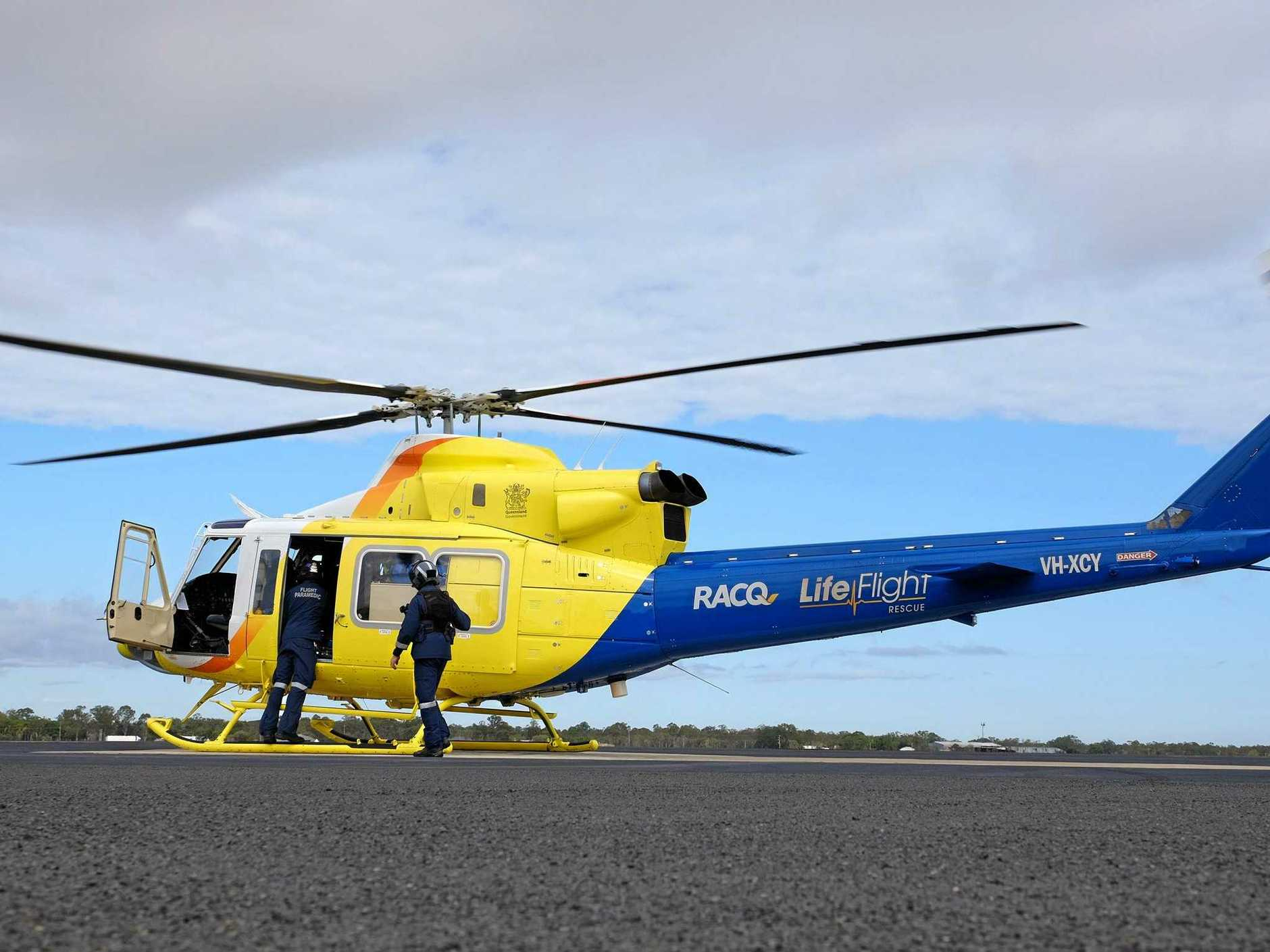 RACQ LifeFlight Rescue is on its way to Lowmead to treat three people for fire-related injuries.