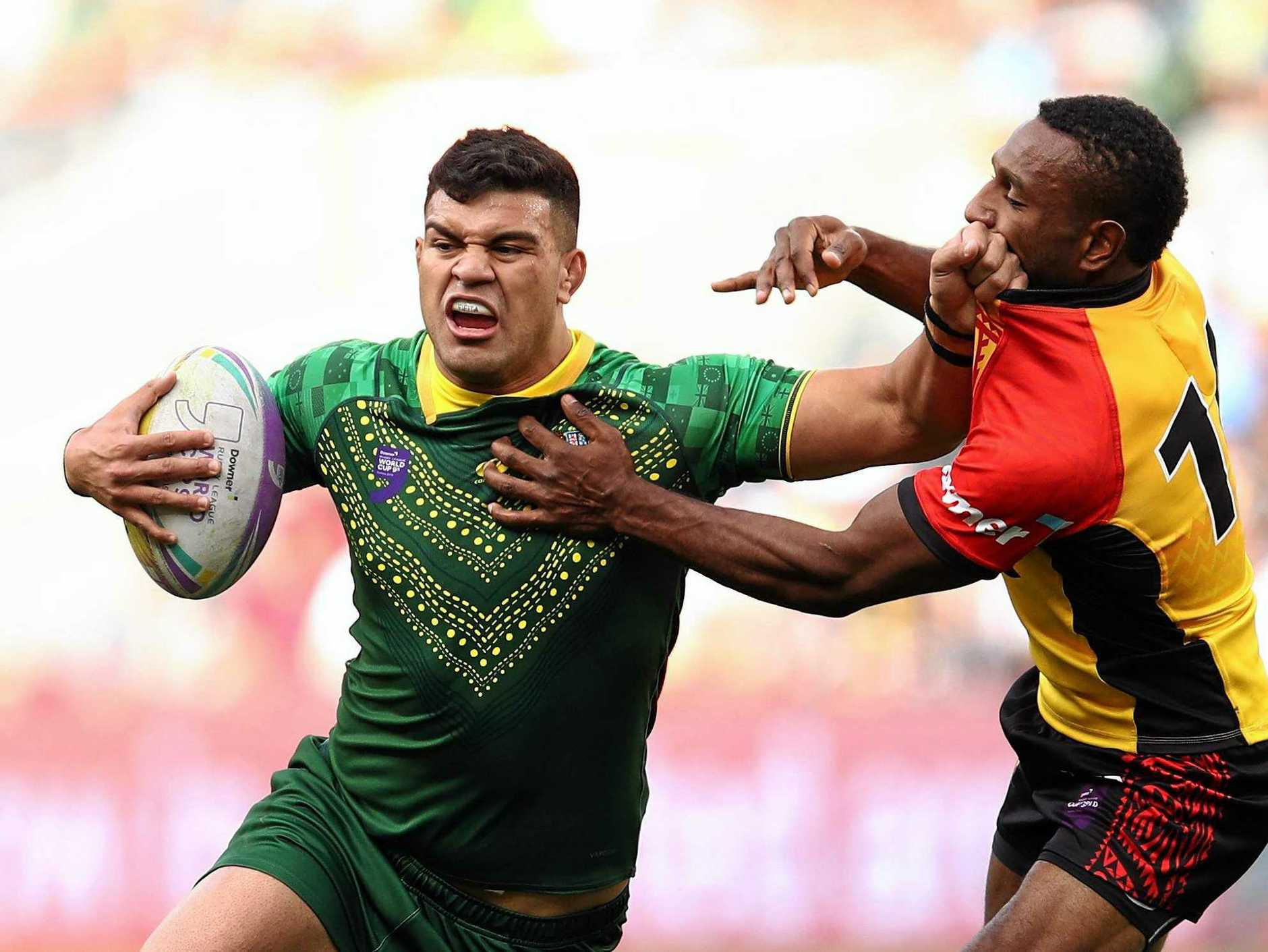 Australia's David Fifita of Australia is tackled by the PNG defence at the World Cup Nines at Bankwest Stadium, Sydney on Saturday. Picture: Brendon Thorne/AAP