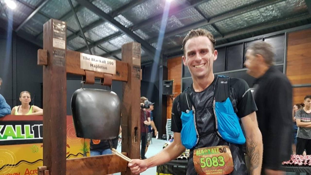 Caloundra's Josh Corcoran charged across the finish first in the men's 50km race during the Blackall 100 on Saturday. Photo: Blackall 100 social media