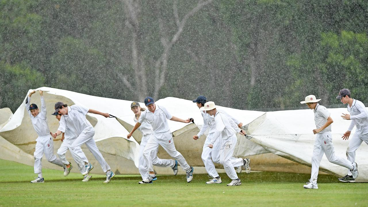 WEATHER: Race to get the covers over the pitch as the rain comes down between the cricket match of Maroochy U124 Reds V U16 Blues. Pictured (centre) Chelsea Parker and Stewart McArthur. Photo Patrick Woods / Sunshine Coast Daily.