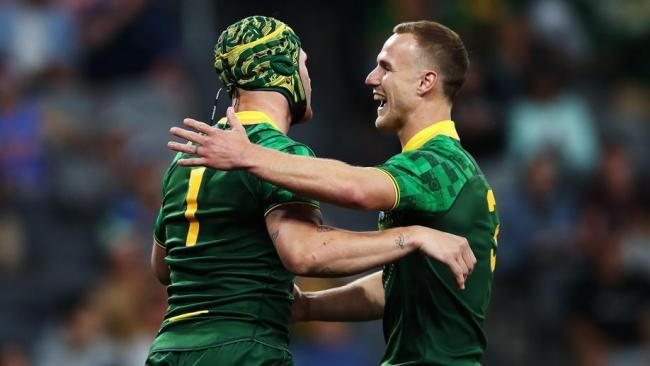Moses hat-trick seals World Nines for Kangaroos