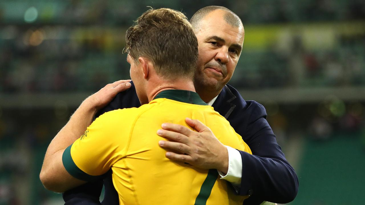 Wallabies coach Michael Cheika hugs captain Michael Hooper after the quarter-final loss to England. Picture: Getty Images