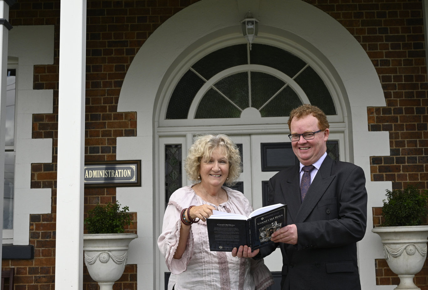 Author Felicity McArdle and St Mary's principal Michael Newman with the book God Old Boys: