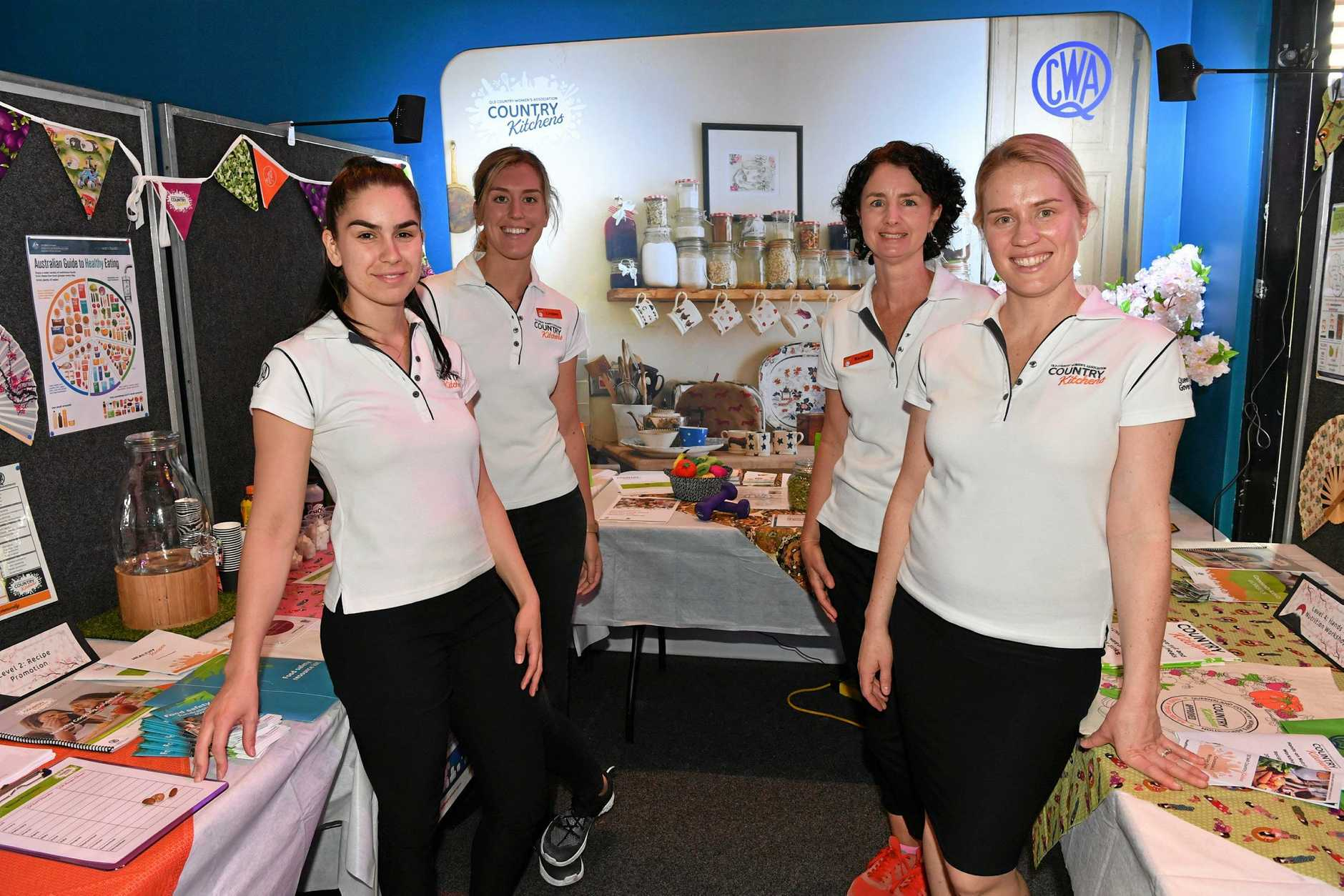 WOMEN'S WARES: Aleks Lukovic, Lindsey Nash, Rachael Belot and Anna Lynch from the QCWA Country Kitchens program at the Creative and Practical Arts Exhibition.
