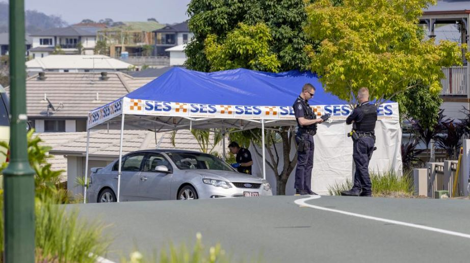 Queensland Police examine a silver sedan following the death of a man on Saturday night. Picture: AAP Image/Richard Walker
