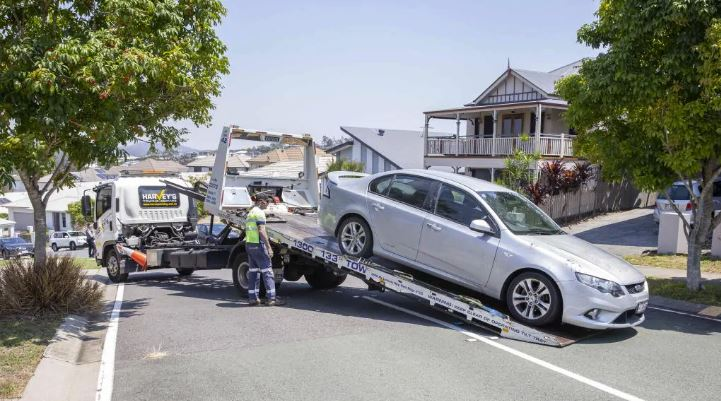 The silver sedan is towed from scene. Picture: AAP Image/Richard Walker