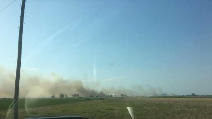 Smoke blankets Valley as crews rush to grass fire