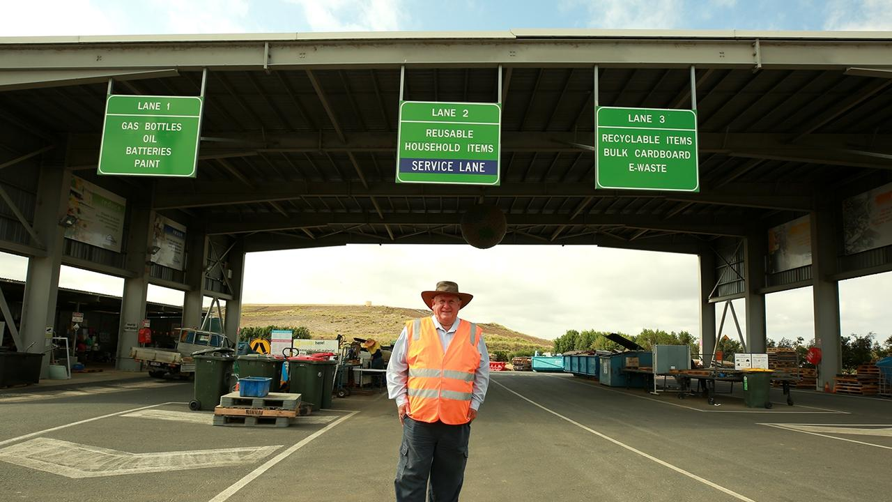 Councillor Fisher at the Lakes Creek Road Waste Management Facility recycling area.