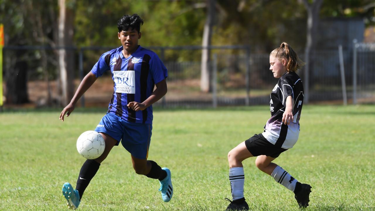 Soccer: Callide's Charlie Barsby and Bluebirds White's Nichal Sahandra.
