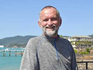 Shark attack doctor back at scene one year on