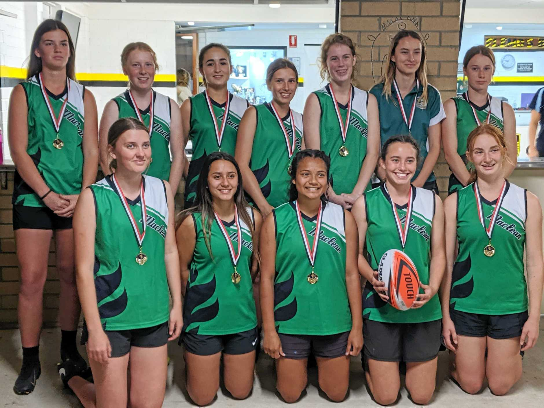TOP GIRLS: Maclean High School, senior girls winners of the Daily Examiner Shield touch football gala day at the Yamba Sports Complex on Monday night.
