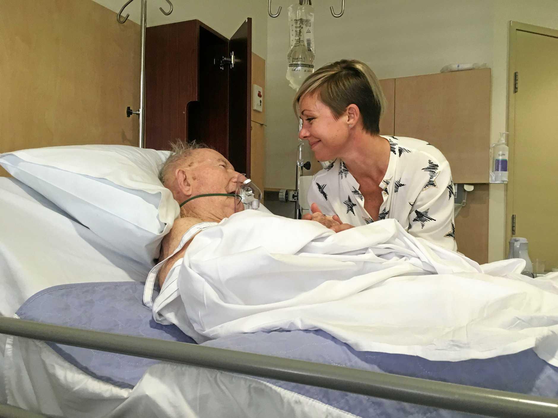 Ted Bleakley in hospital with grandaughter Carmel.