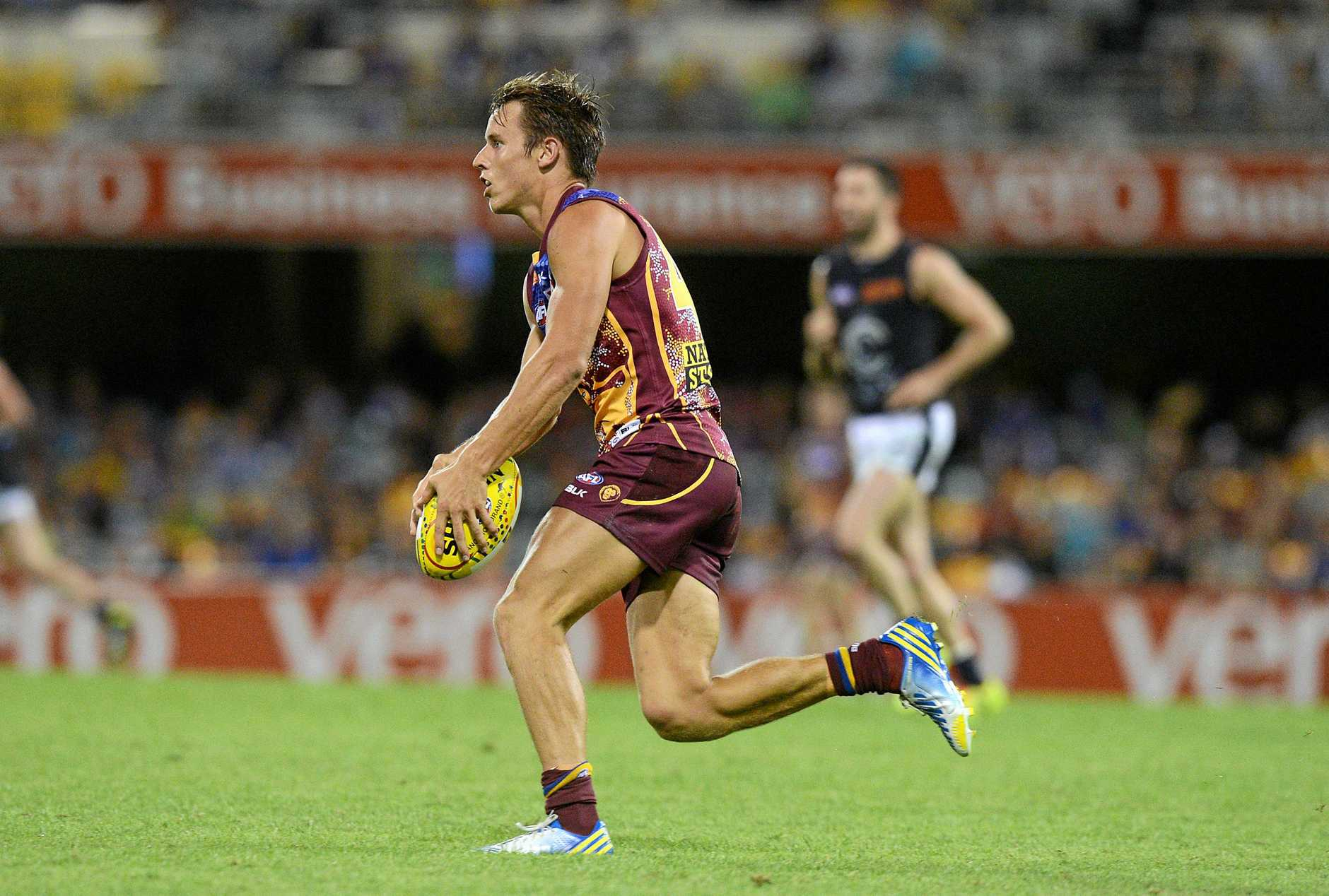 Zac O'Brien in a match again Carlton at The Gabba in 2014 during his professional football career with the Brisbane Lions.
