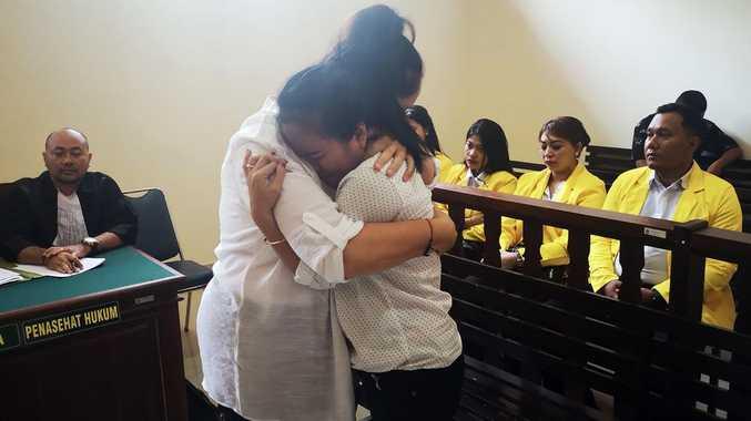 Accused Aussie hugs victim's mother in court