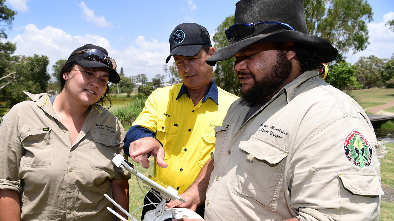 TRAINING: Bunya Mountains Murri rangers Allysa Brown and Hedley Bell with drone trainer John Coulombe (centre).