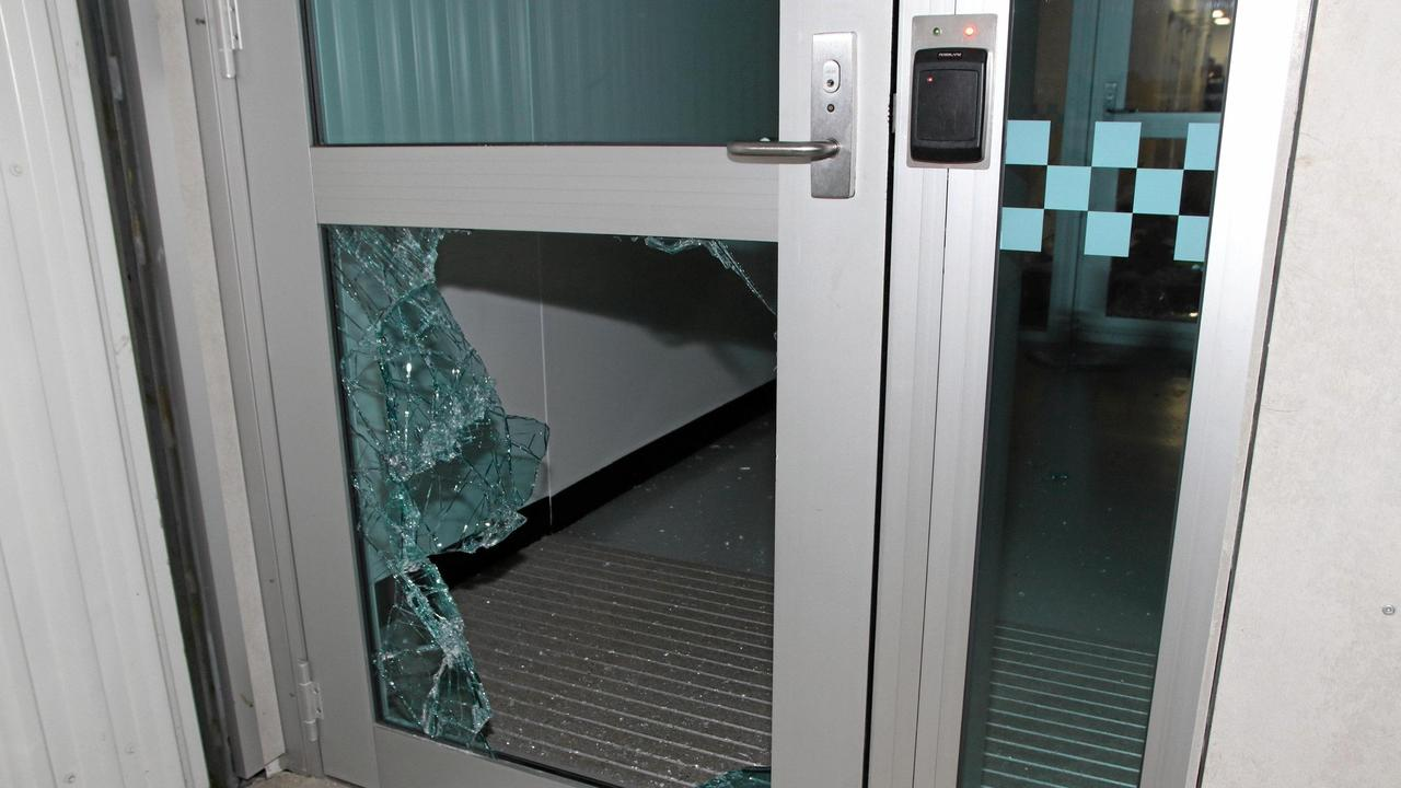 The back door at Bowen Police Station after a 35-year-old man allegedly smashed his way in before being shot by police. Picture: Queensland Police