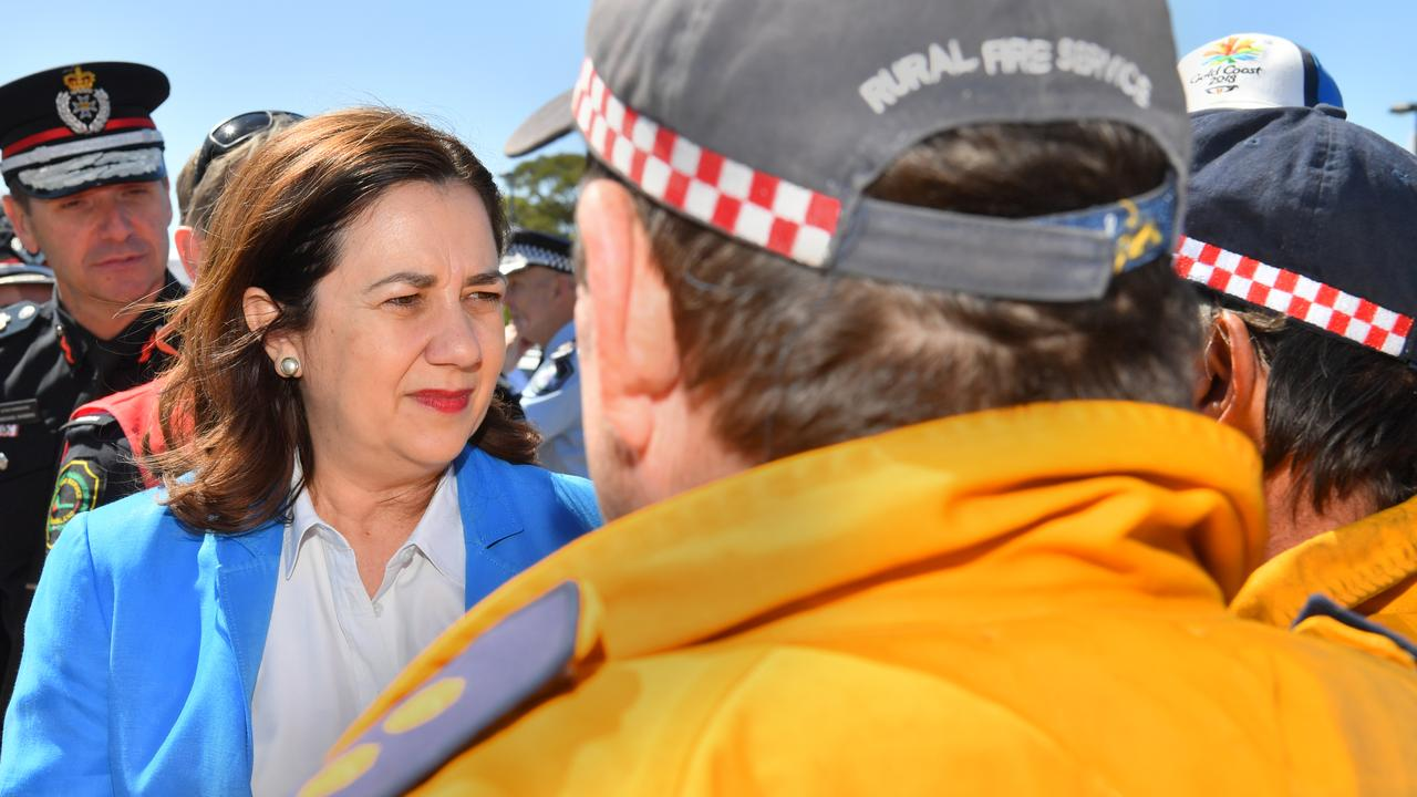 Queensland Premier Annastacia Palaszczuk came to the Sunshine Coast to pay tribute to the colossal effort and courage shown by the QFES and Rural Fire Brigade volunteers during the horrendous Pegeian fires. Now her government has suspended their uniform requests because they won't apply for Blue Cards they say they don't need. Photo: John McCutcheon / Sunshine Coast Daily