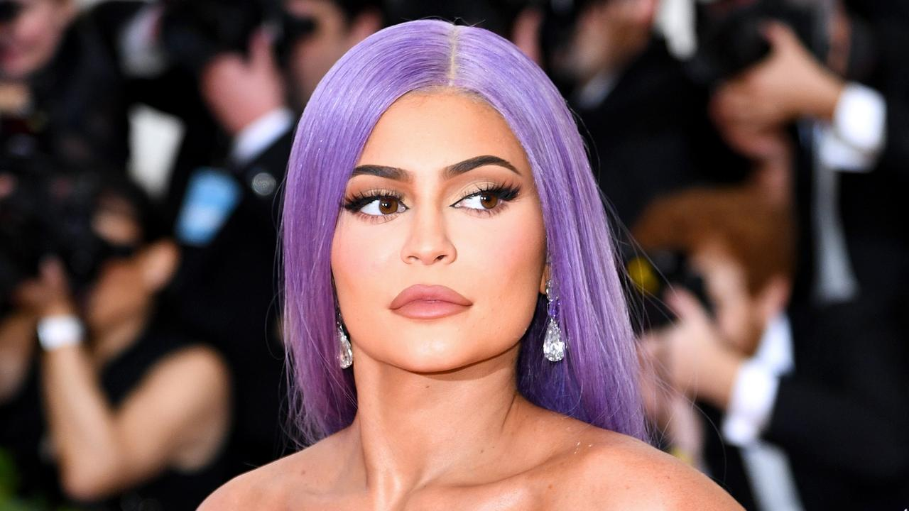 Fans were intrigued by an unexpected turn in a video clip — the way Kylie Jenner sung to her little girl — and now she's selling jumpers with her famous three words on it.