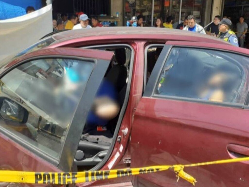 The red Mitsubishi Mirage following the shooting. Picture: Twitter/@zhandercayabyab/Raoul Esperas