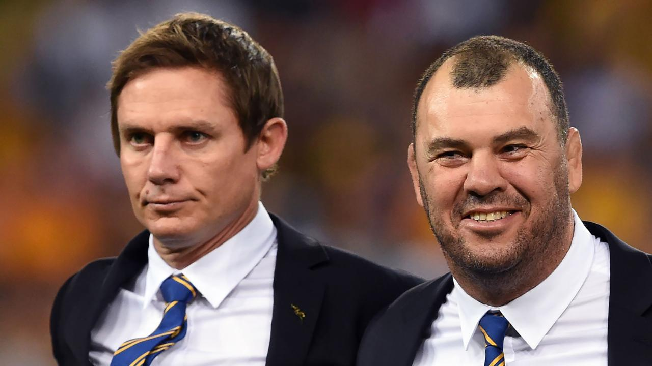 Stephen Larkham (L) could be one of the candidates to replace outgoing Wallabies coach Michael Cheika. Picture: AFP