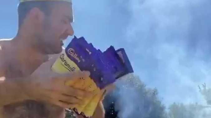 WATCH: Fury as man burns '$16,000' of Caramilk