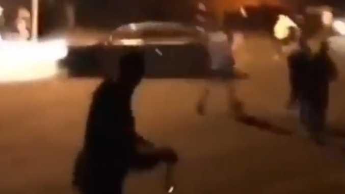 Moment hoons attacked Coast cop car