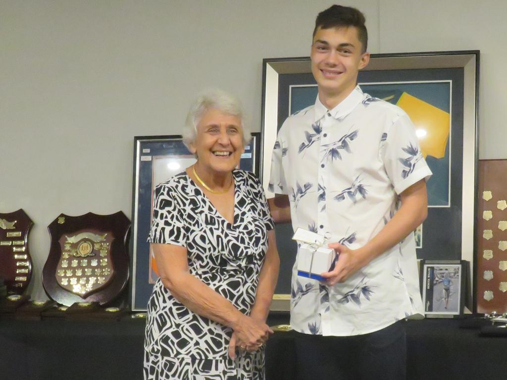 Life member Agnes Farmer presents Will Morgan with his 3rd place Open Male Club Championship award.