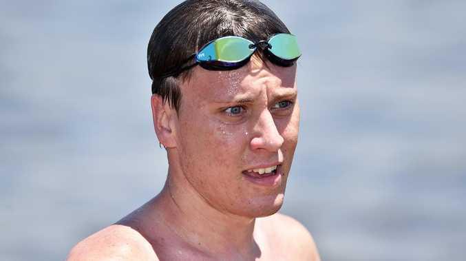 Swim champ intent on improving for Games bid