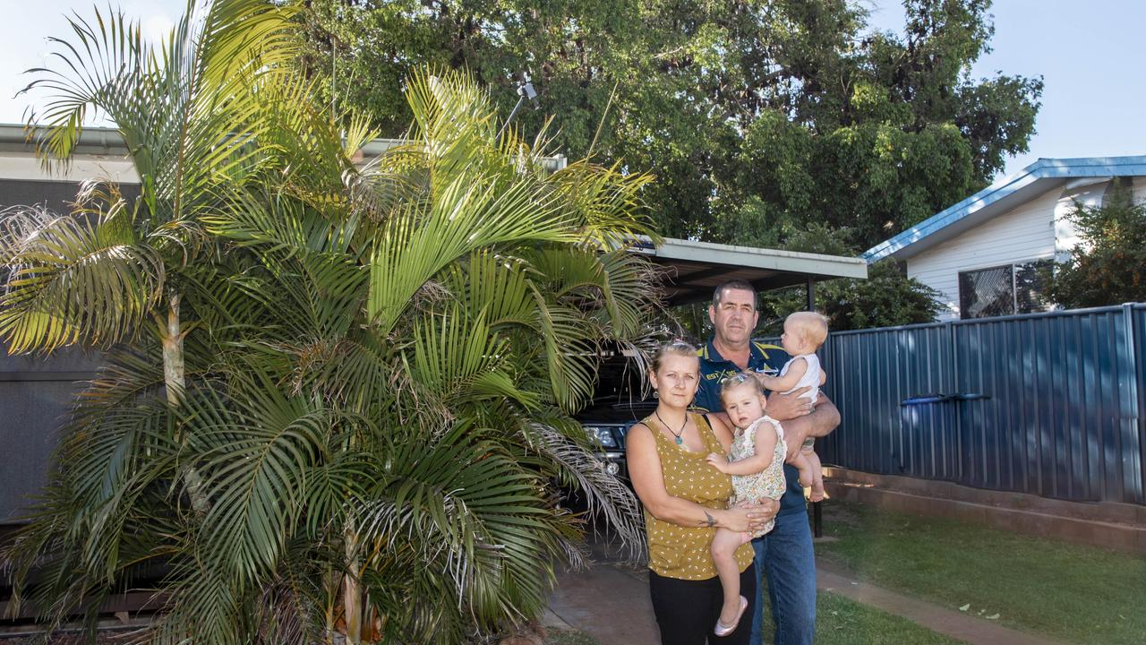 Brooke Love and Darren Craig with their two children Ena and Zac standing in front of their home as bats hang over their back yard. Picture: Anne Hartung