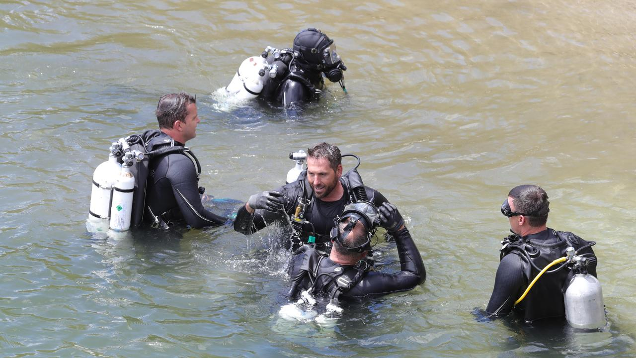 Police divers search for clues in Tallebudgera Creek. Picture Glenn Hampson