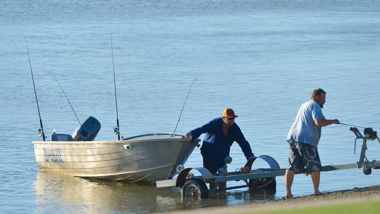 Watch the fishing boats return to shore near Gladstone Yacht Club.