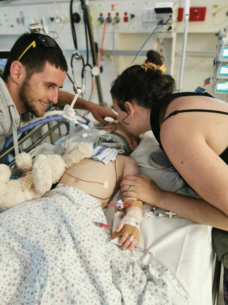 Lorelei in hospital with her mum Elise and dad Ben.