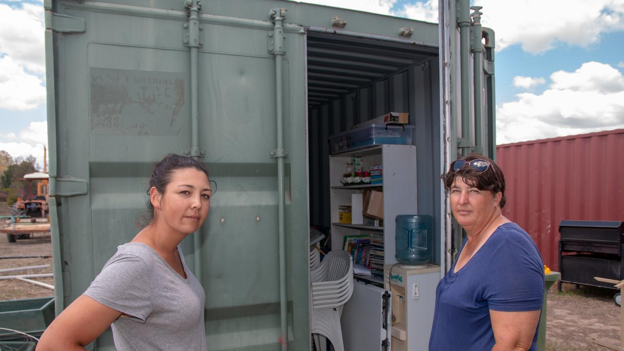 Lockyer Valey RDA volunteer Siranee Parkinson and Secretary Bobbi Dingle with one of the shipping containers broken into.