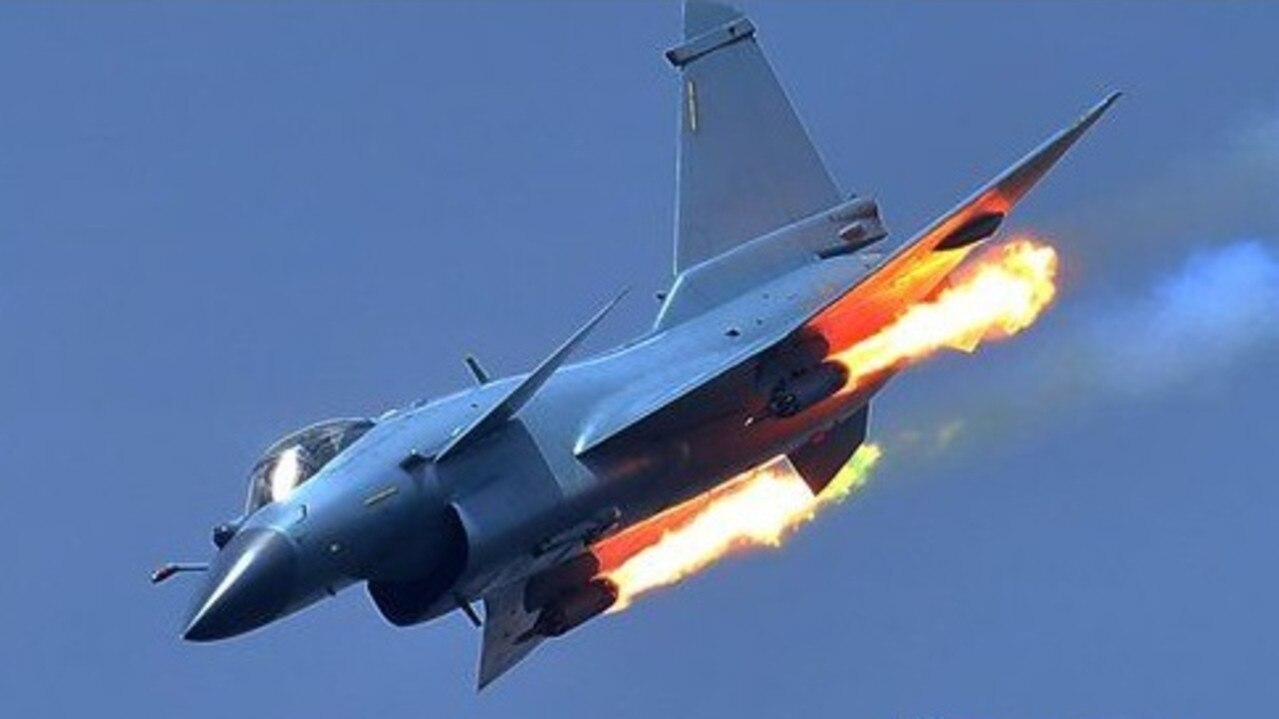 A Chinese J-11 fighter jet practices firing rockets at a weapons range