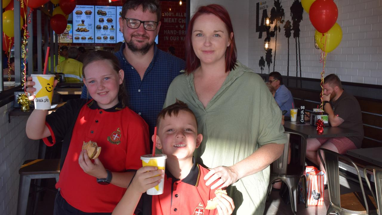 Sasha and Lewis Carolan with children Ava, 10, and Leo, 7, trying out Carl's Jr on the opening day on Tuesday. The children gave the burgers a big thumbs up.
