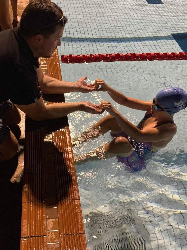 Adults need to assist children as they launch into backstroke at the Clermont Pool