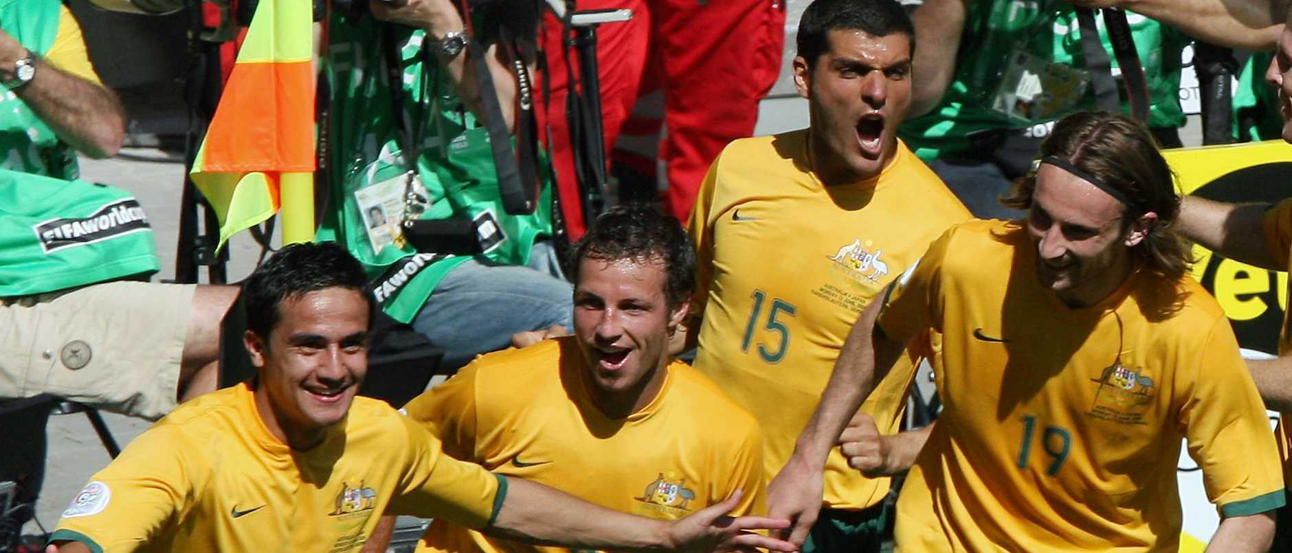 Australian midfielder Tim Cahill (L) celebrates with teammates after scoring his second goal against Japan in their first round Group F World Cup football match at Kaiserslautern's Fritz-Walter Stadium, 12 June 2006. Australia won the match 3-1. AFP PHOTO/VALERY HACHE