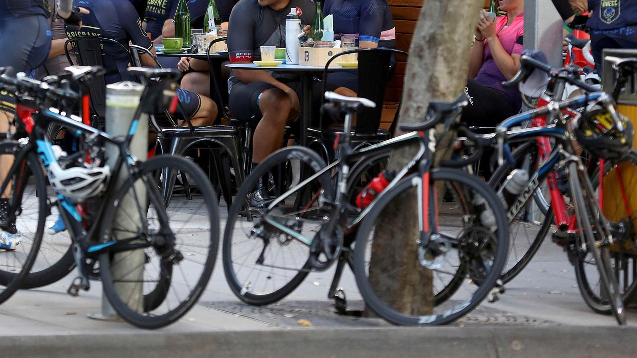 Townsville cafe owner Ann Reid is dismayed sweaty cyclists sit on her fabric chairs.