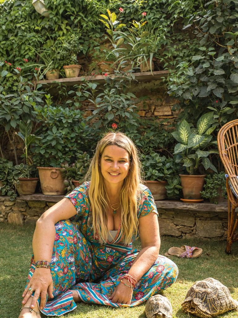 Dui Cameron and a couple of her Indian tortoise friends at her Pushkar home
