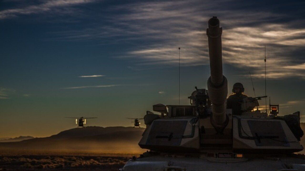 A US tank is flanked by helicopters during recent war-games. Picture: US Department of Defence