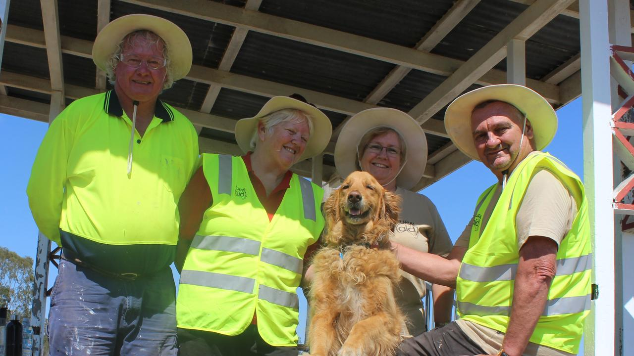 Rural Aid volunteers Bernie Rankmore, Chirley Semmens and Janice James with her dog Alford and their team leader Bill Wallace.