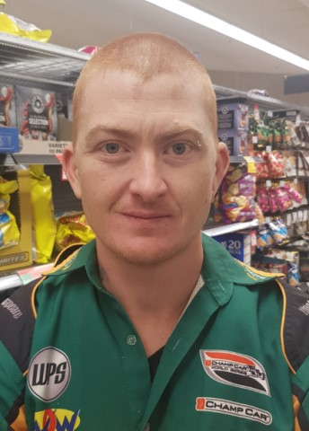 Jerome Davis. Jerome is described as Caucasian, 178cm tall, with a proportionate build, hazel eyes and a shaved head. He was wearing a black and red 'Ed Hardy' skull t-shirt, shorts, green Quiksilver thongs and white 'Oakley' sunglasses.