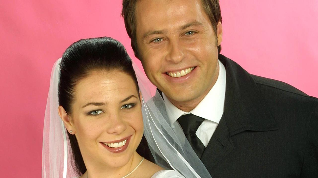 Actors Kate Ritchie and Joel McIlroy in wedding episode of TV show Home And Away.