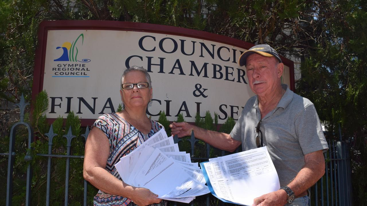 Jan Watt and Tom Marshall with their petitions to change the Mary Valley dump hours in 2017.