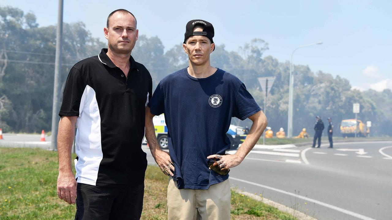 Mates Jason Brinkley (right) and Joseph Cooper (left) were evacuated from Joseph's Peregian Beach home this morning. Photo: Patrick Woods
