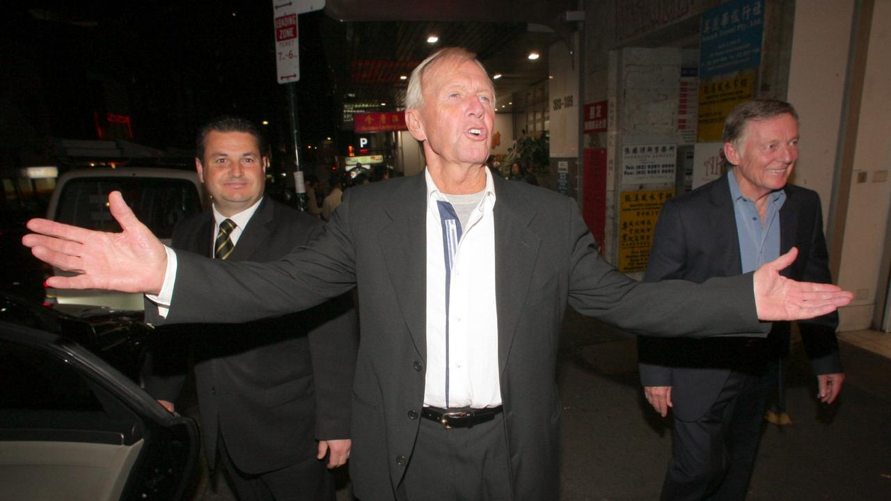 Hogan (centre) and John Strop Cornell (right) leave a Chinatown seafood restaurant where they dined with their families after the ATO banned Hogan from leaving Australia in 2010.
