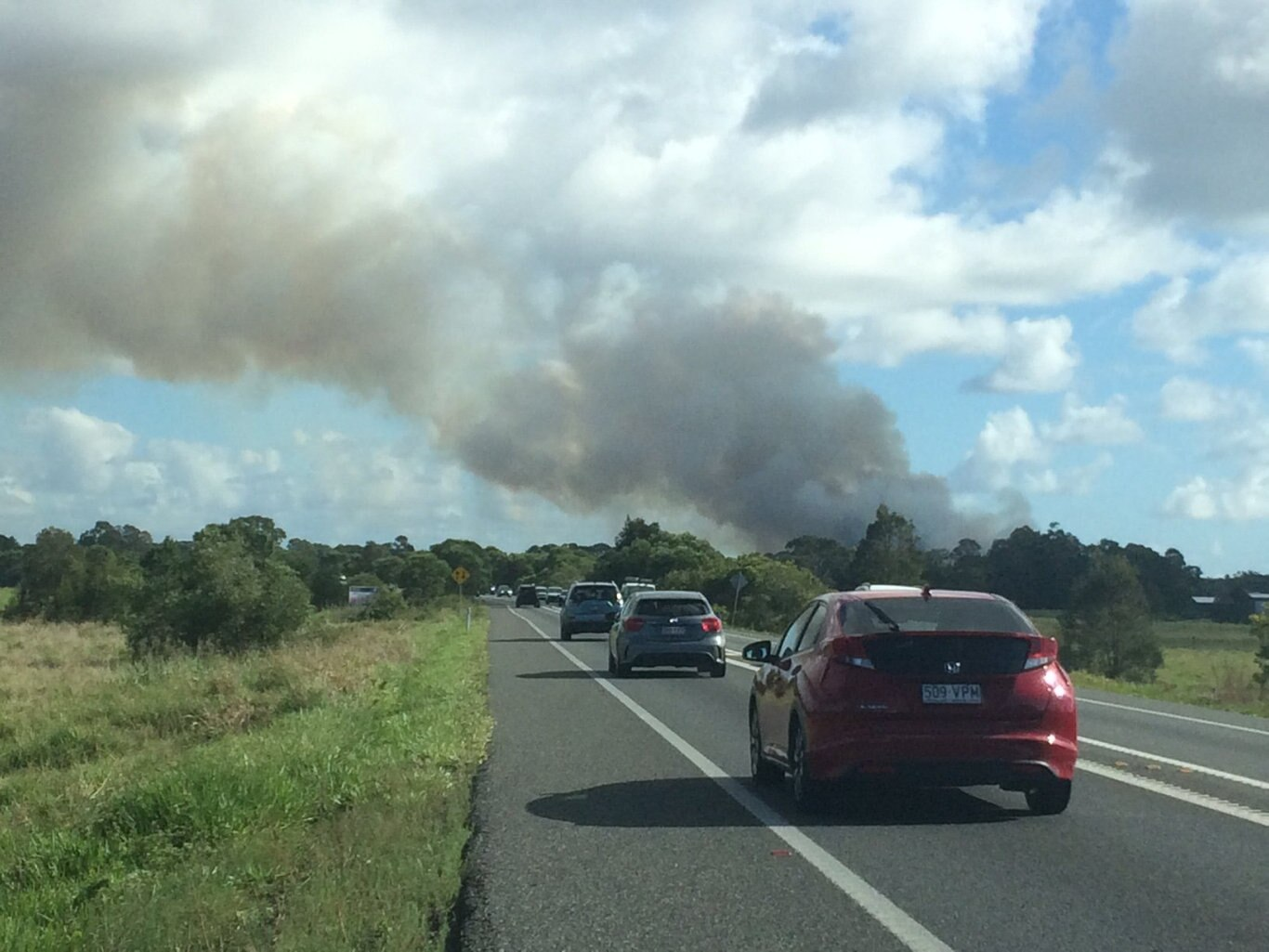 Large plumes of smoke can be seen across the Coast after a grass fire broke out at Peregian and Coolum Beach this morning.