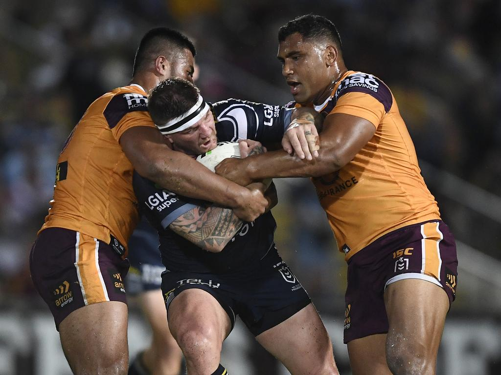 Josh McGuire of the Cowboys is tackled by Payne Haas and Tevita Pangai of the Broncos in round 21 of the 2019 NRL season. Picture: Ian Hitchcock/Getty Images