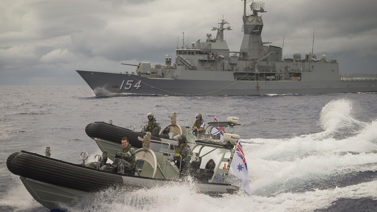 HMAS Parramatta's seaboats speed away from the ship in the waters of Yap, Micronesia in 2017.