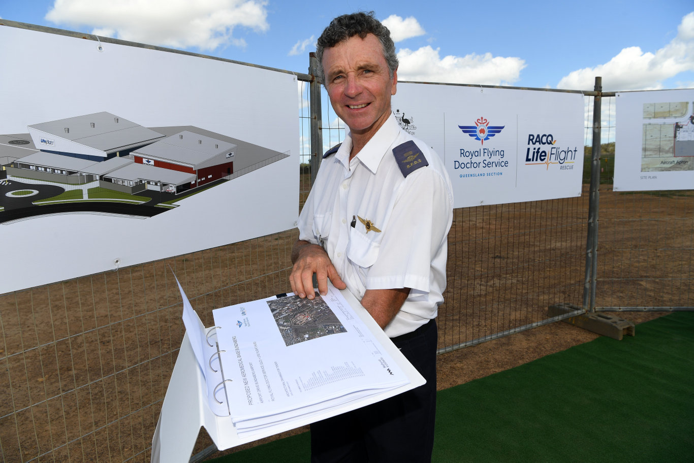Haydn Frisby studies the plans for the proposed new aeromedical base at the Bundaberg airport.